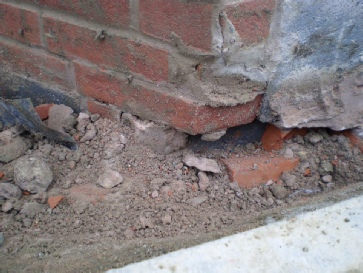 Brickwork supported on foundations?  They didn't even try to hide it!